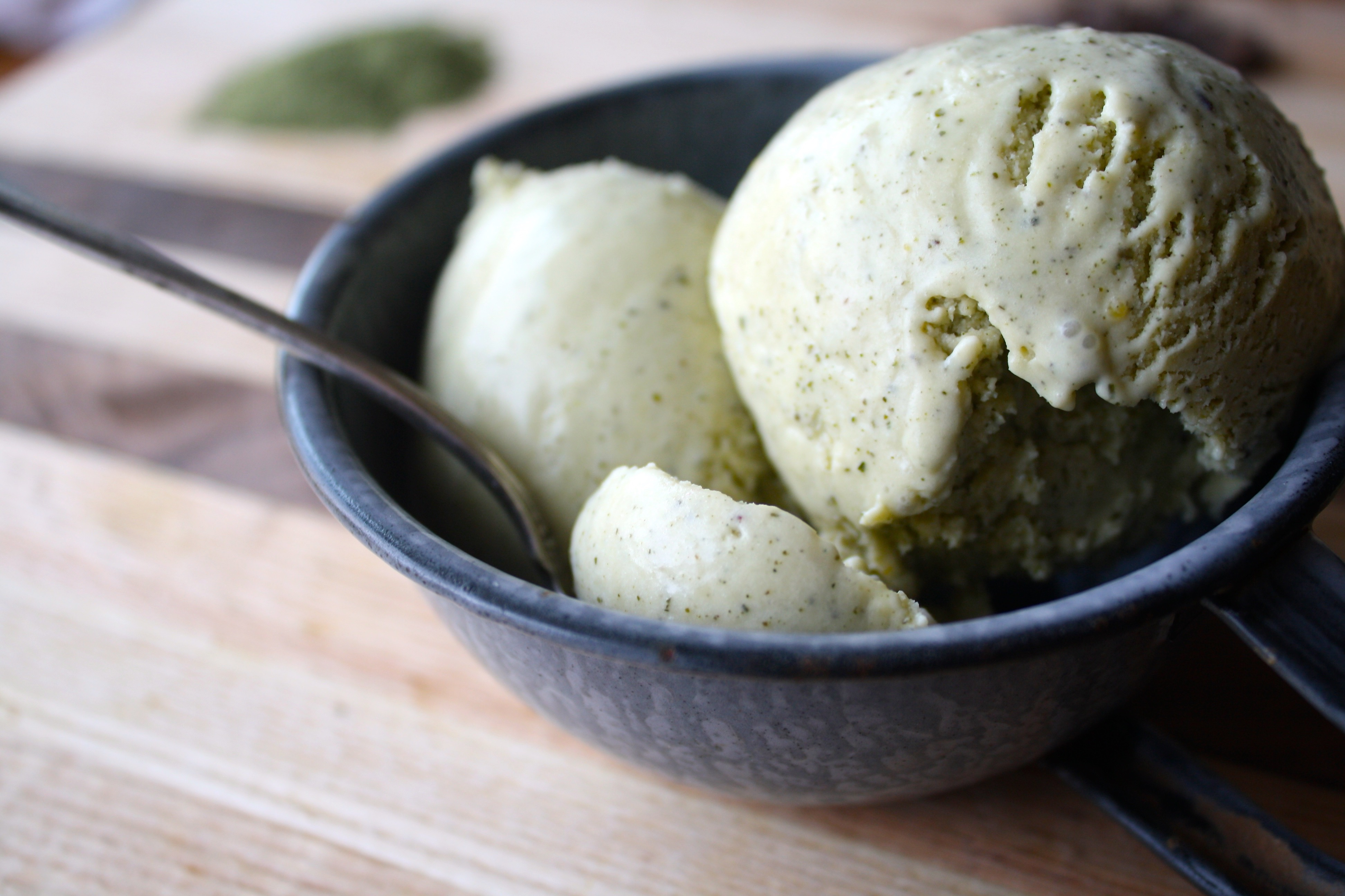 Photograph of green tea ice cream set in a gray metal bowl