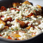Baked Eggs with Tomatoes, Feta, & Croutons from the Complete Mediterranean Cookbook