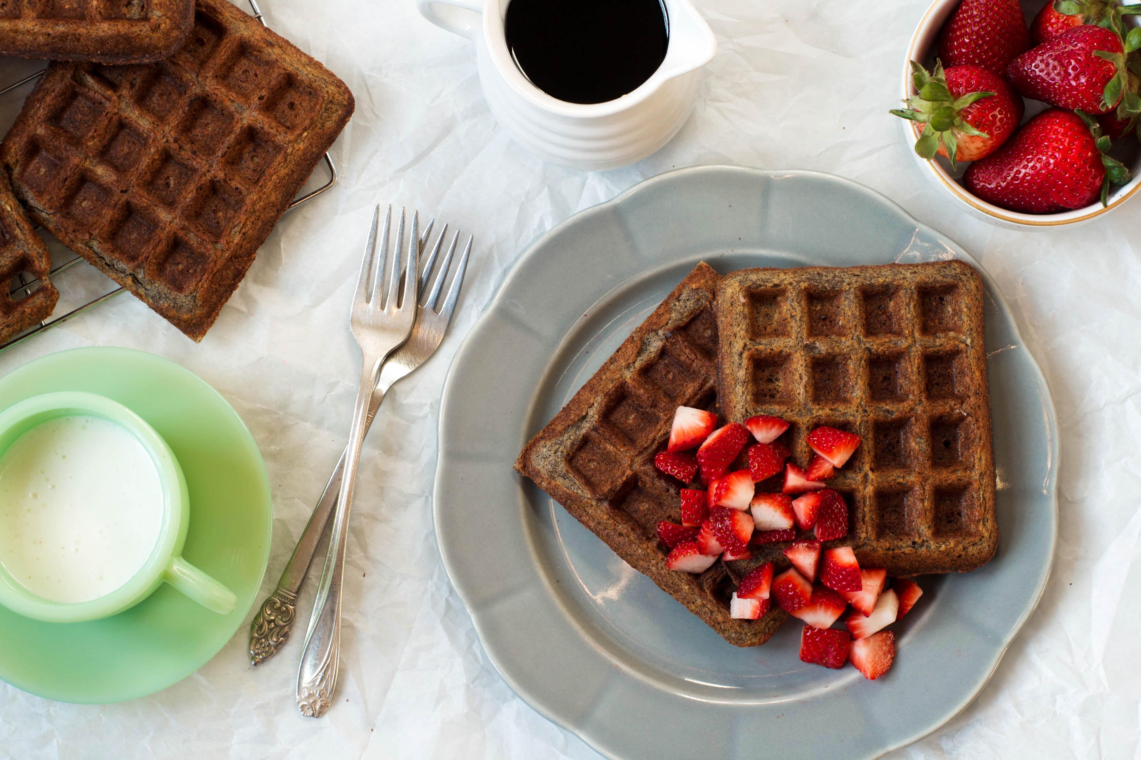 Gluten Free Buckwheat Waffles on a gray plate with strawberries | Zestful Kitchen