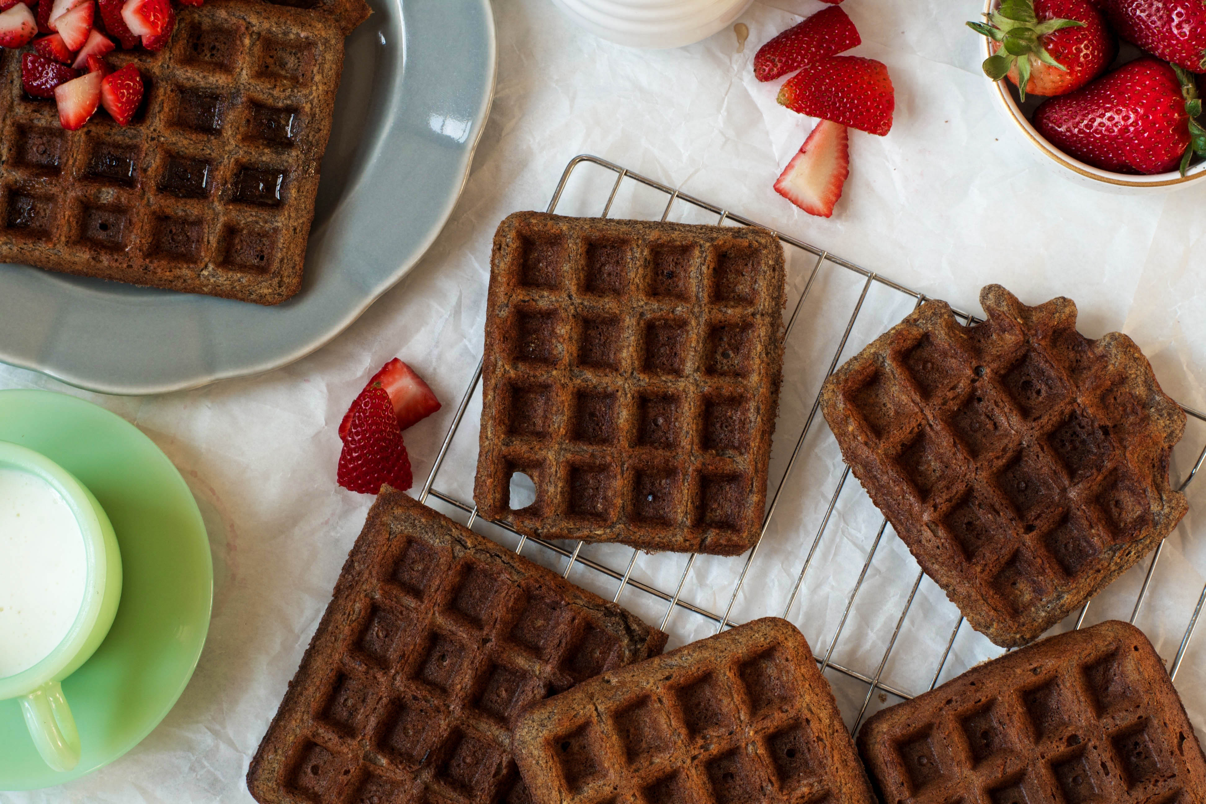 Gluten Free Buckwheat Waffles on white parchment paper and cooling rack | Zestful Kitchen
