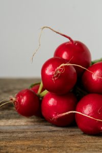 Vibrant red radishes on a wood table