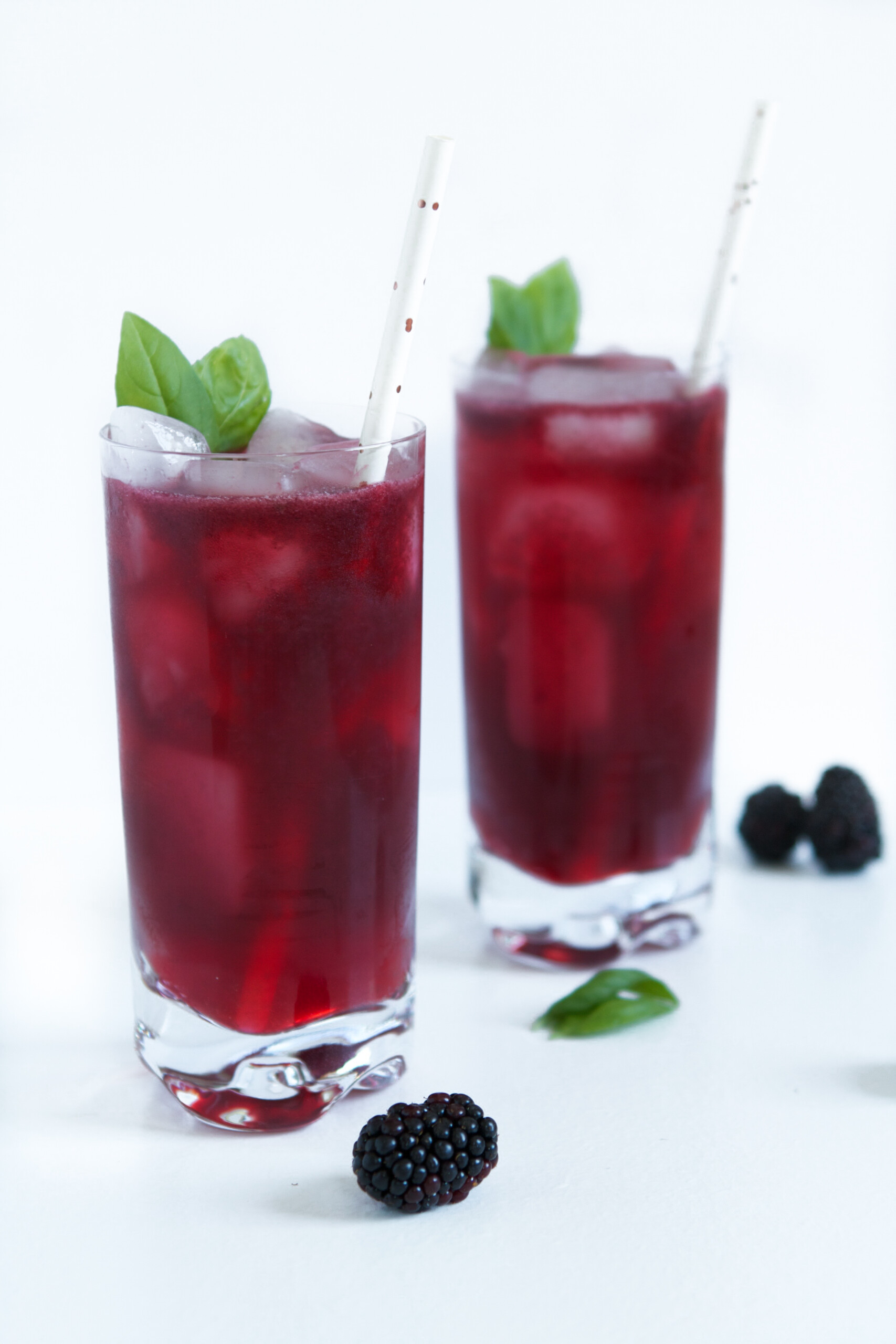 Muddle blackberries and sugar in a cocktail shaker. Add basil and lightly muddle until fragrant. Add gin and lemon juice then fill shaker with ice, secure lid, and shake vigorously until thoroughly chilled. Strain into a Collins glass filled with ice and top off with chilled club soda. Garnish with blackberries and basil leaves.