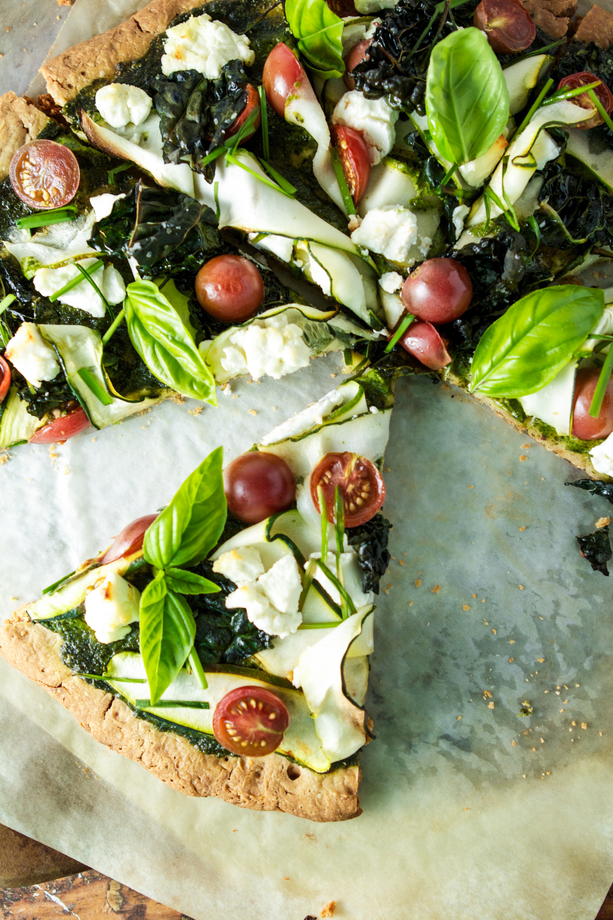 Photograph of a green goddess pizza from overhead | Zestful Kitchen