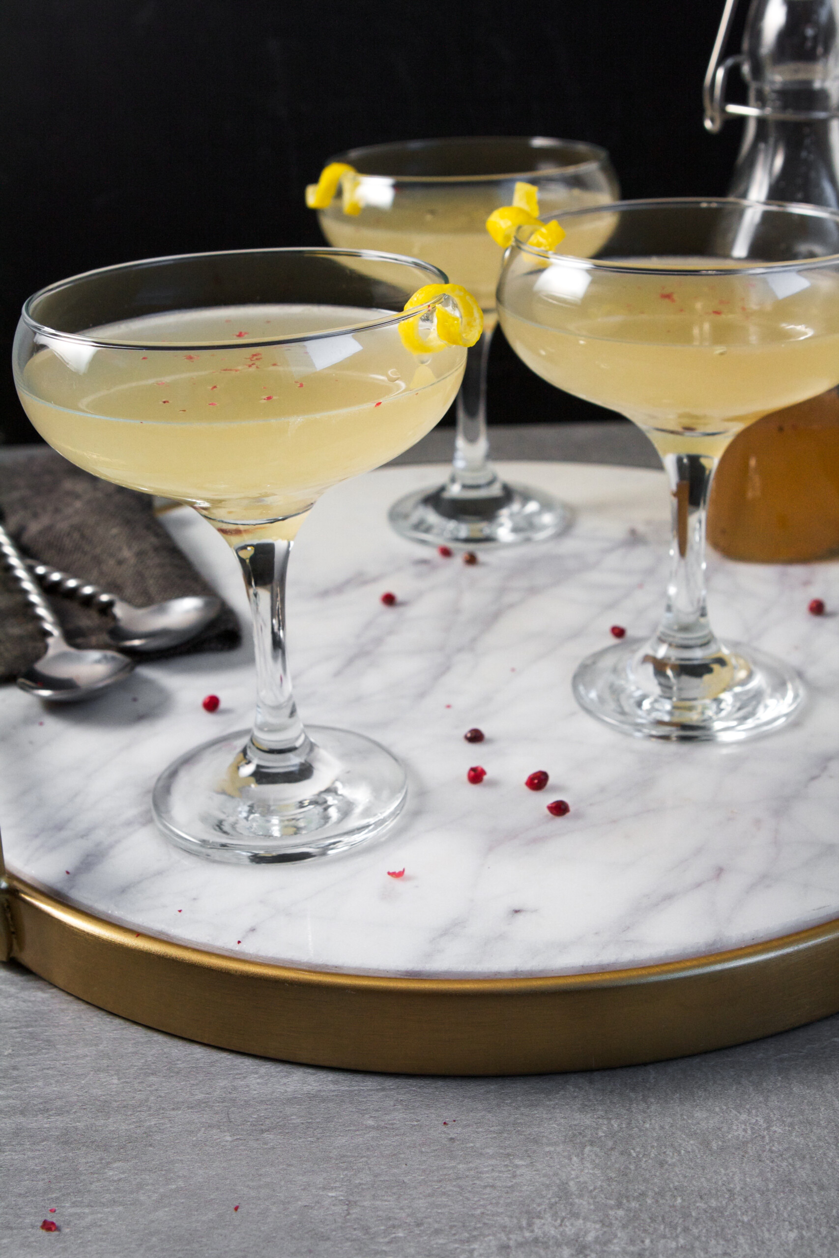 Light and refreshing, this vodka-kombucha cocktail is perfect for any occasion. Made with a pink peppercorn-cardamom syrup and lemon-ginger kombucha, this drink has incredible depth of flavor and festive flare.| Zestful Kitchen