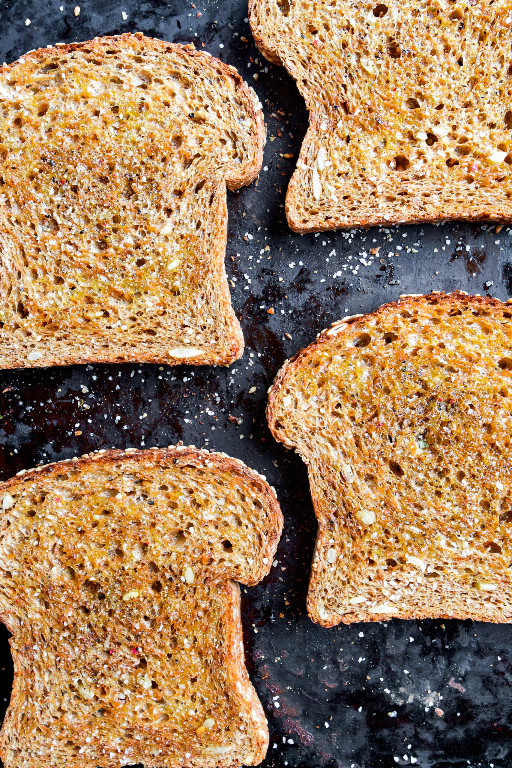 Toasted bread on black baking sheet