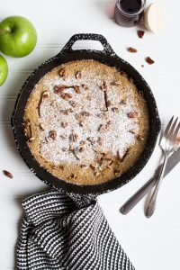 This puffed apple pancake is crisp and golden on the edges, slightly custardy in the middle, and layered with perfectly cooked spiced apples. The perfect fall breakfast! | Zestful Kitchen