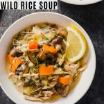 close up photo of creamy wild rice soup with recipe text overlay