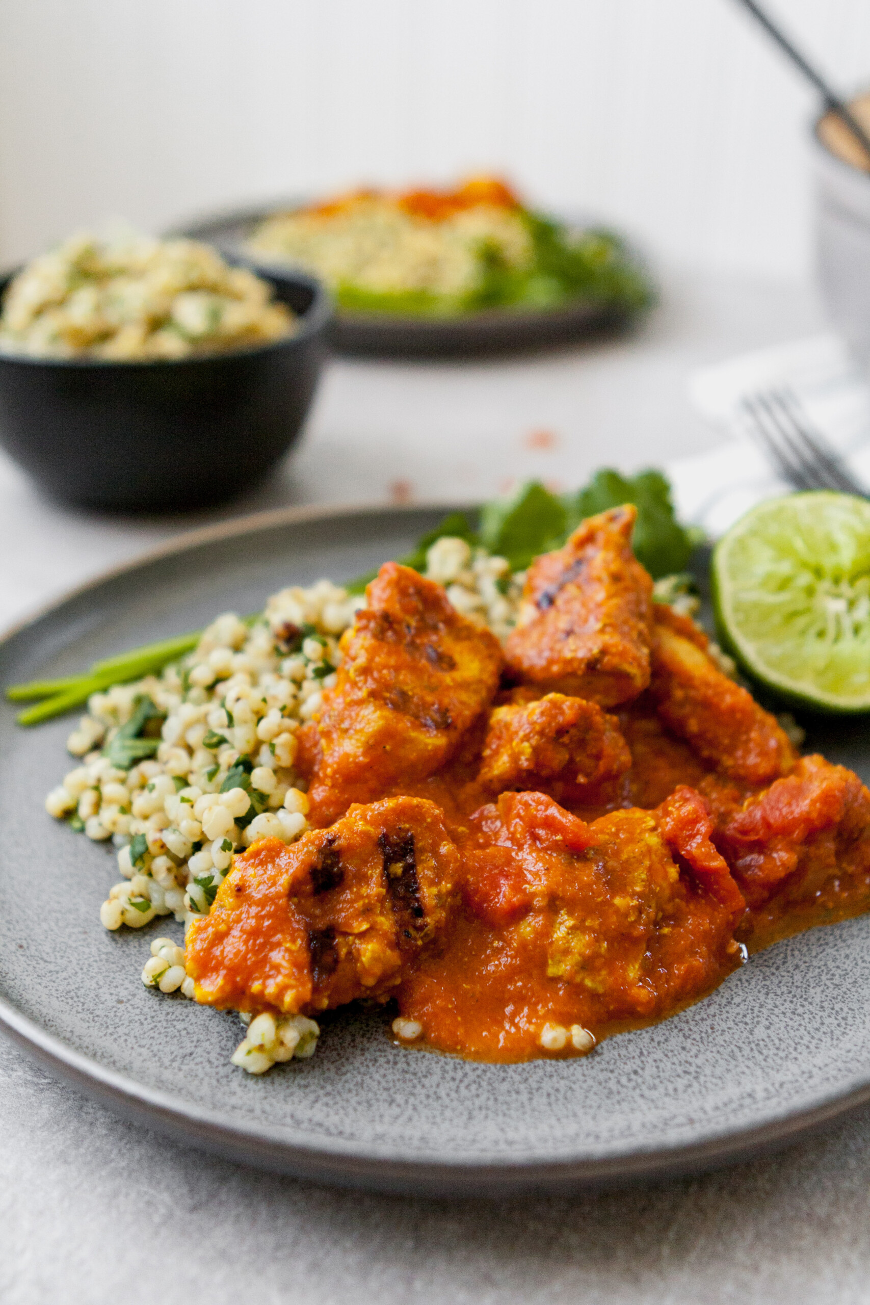 This lightened Chicken Tikka Masala is full-flavored, healthy, and even a great make ahead meal. Atop a bed of cilantro-lime sorghum, this is a classic, reinvented. | from Lauren Grant of Zestful Kitchen