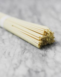 dry bundle of noodles on marble