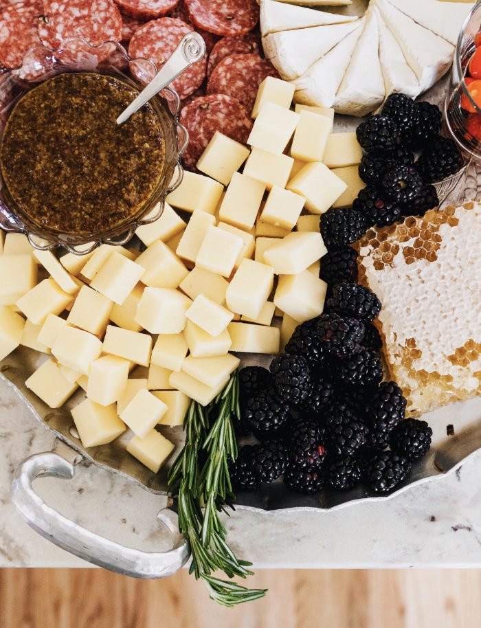 A cheese board styled on a silver platter