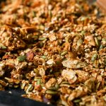 Homemade granola recipe set on a dark baking sheet