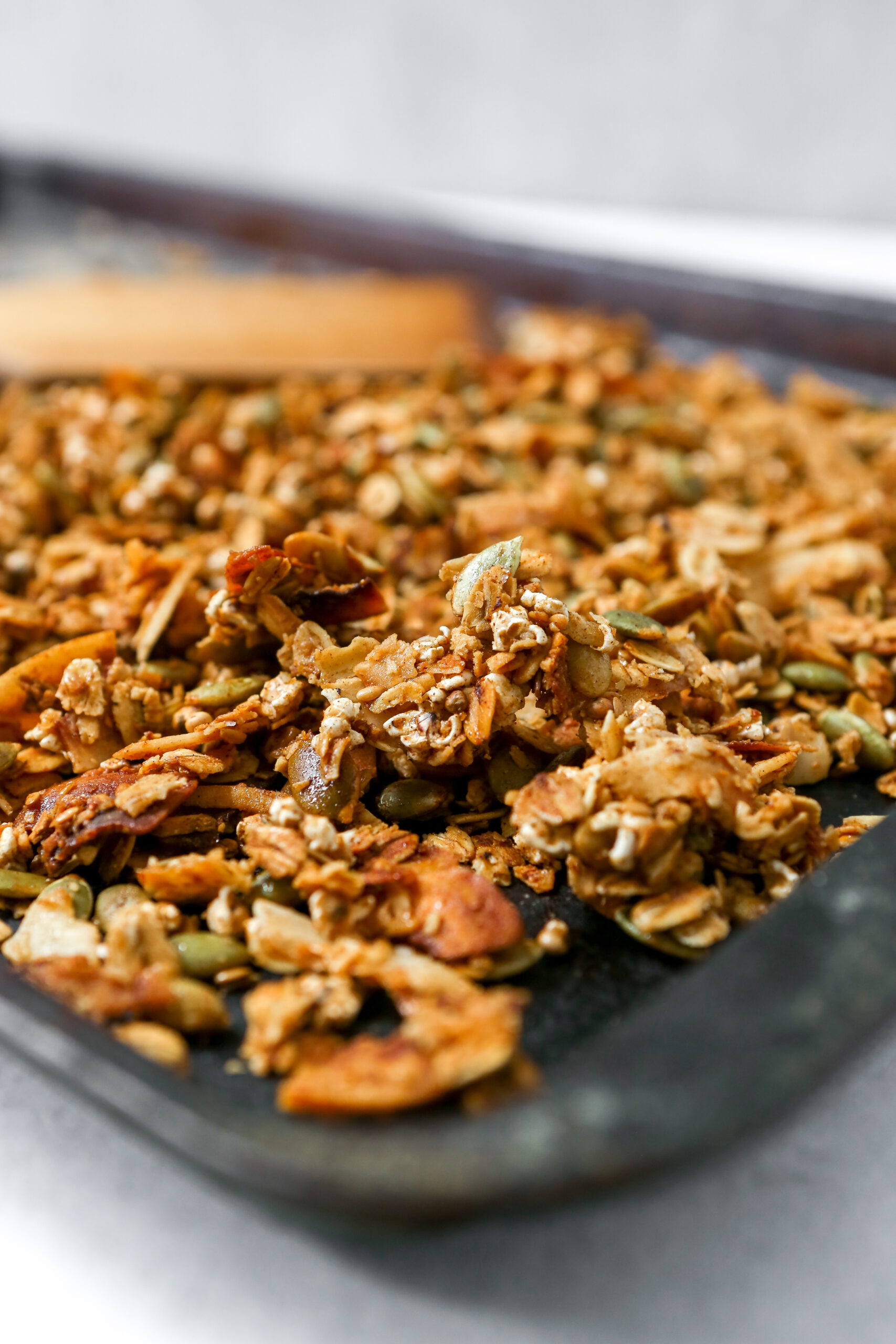 Homemade healthy granola recipe set on a black baking sheet