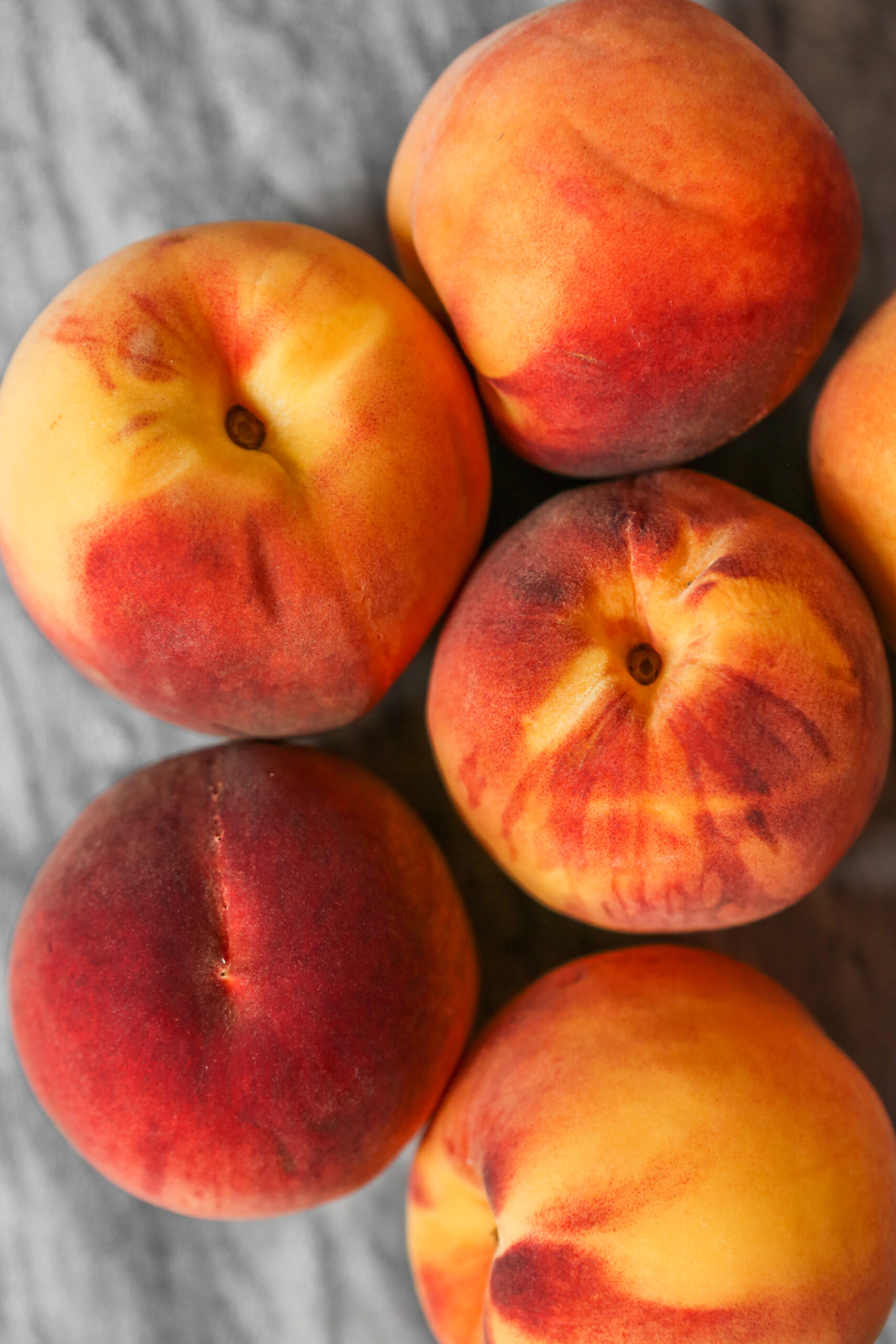 Ripe peaches arranged on a marble surface. Food photography