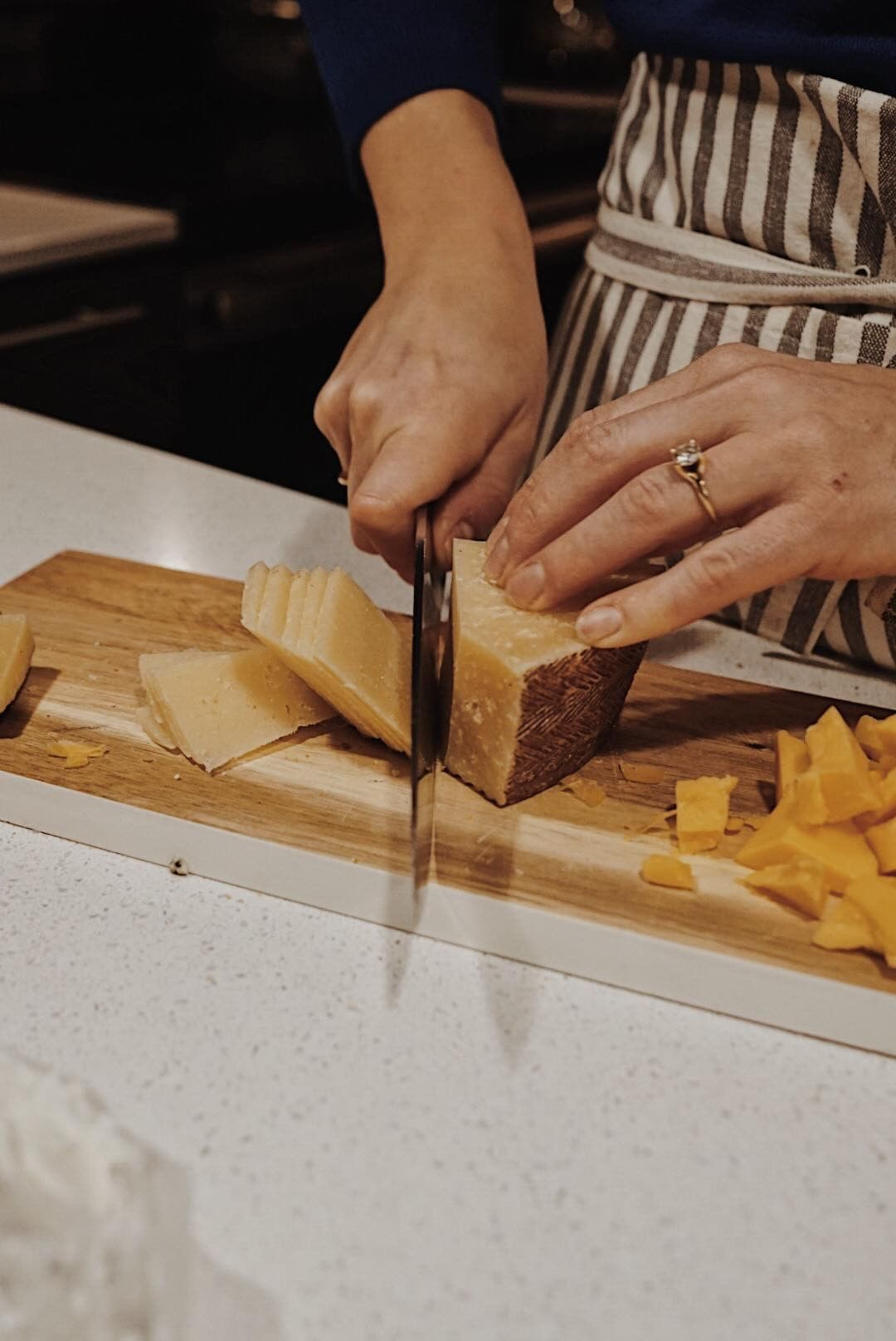 Photograph of someone assembling a cheese board