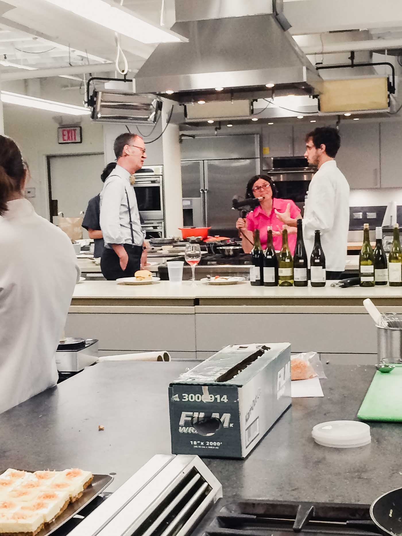 Photograph of America's Test Kitchen with Christopher Kimball and Dan Souza recording a podcast.