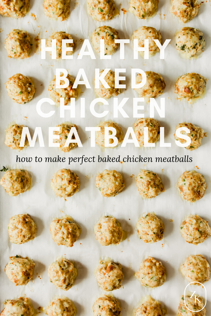 Photograph of unbaked chicken meatballs on a baking sheet