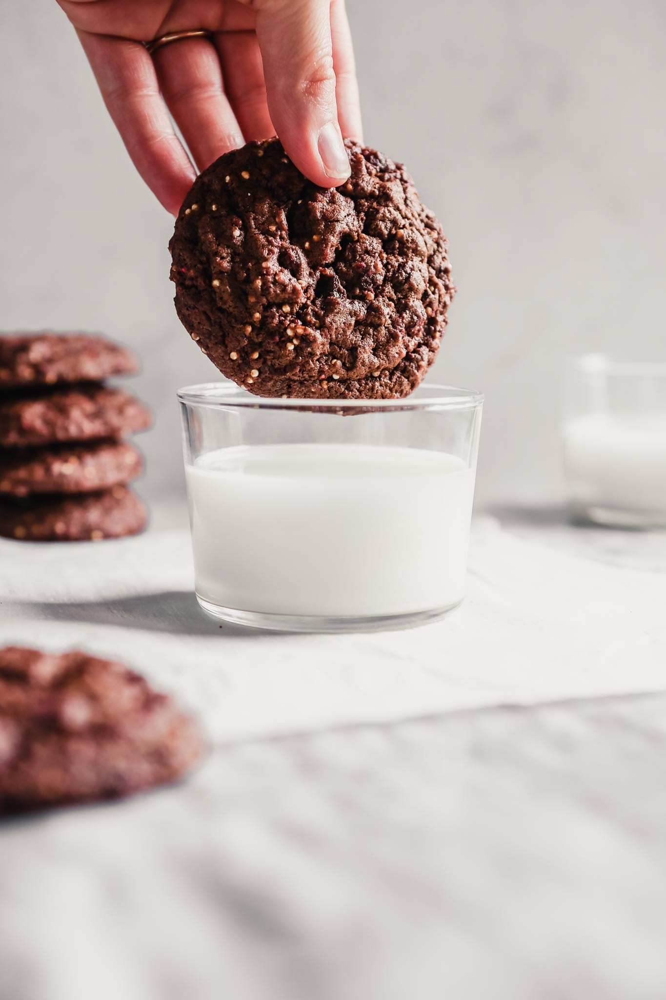 Photograph of a Mexican chocolate cookie being dipped in milk