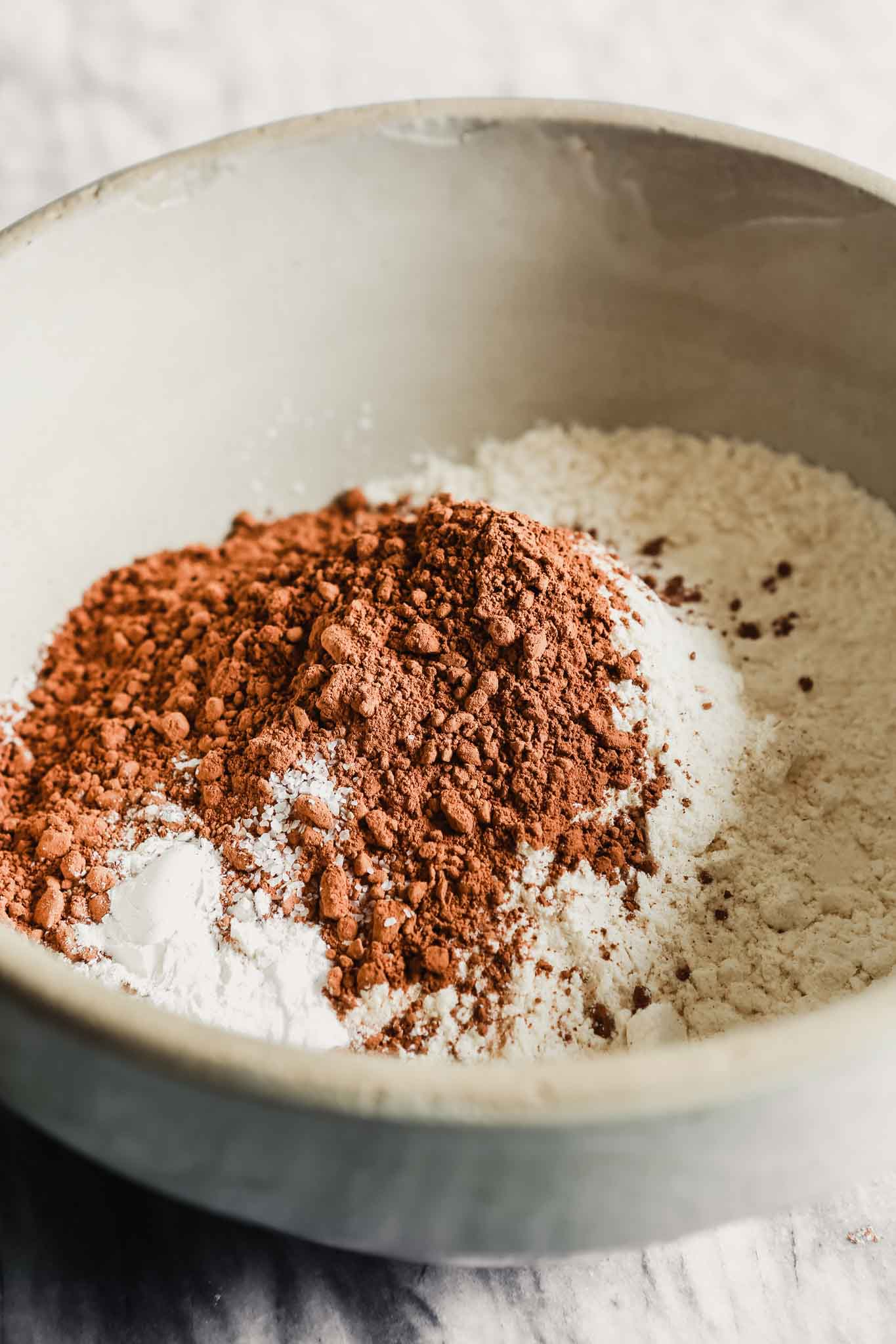 Photograph of flour, cocoa powder, and spices in a mixing bowl