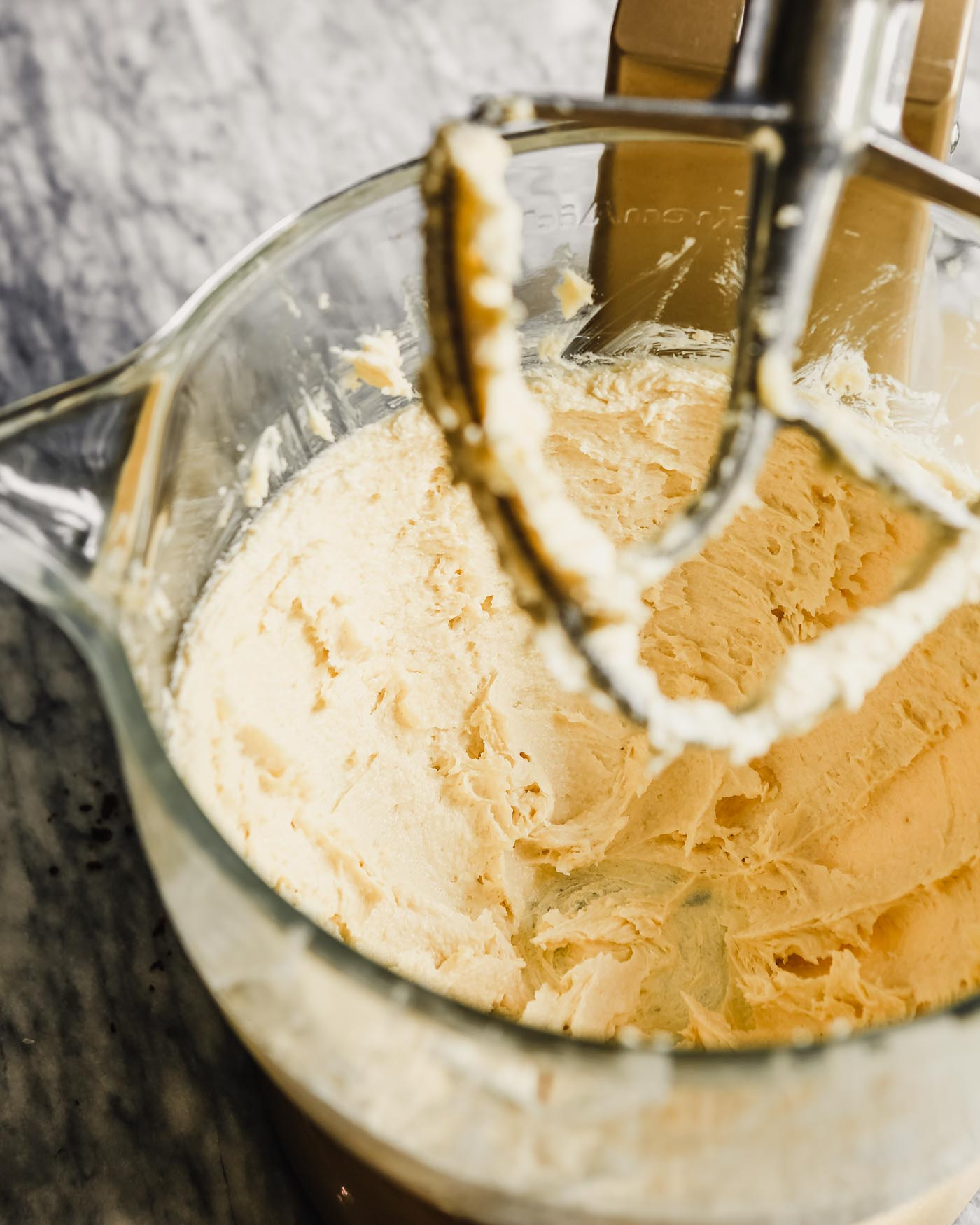 Photograph of whipped butter and sugar in a stand mixer