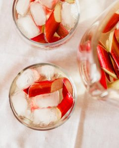 Overhead photograph of a strawberry sangria with rhubarb in glasses with ice