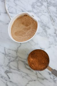 Photo of coconut sugar being ground in a spice grinder