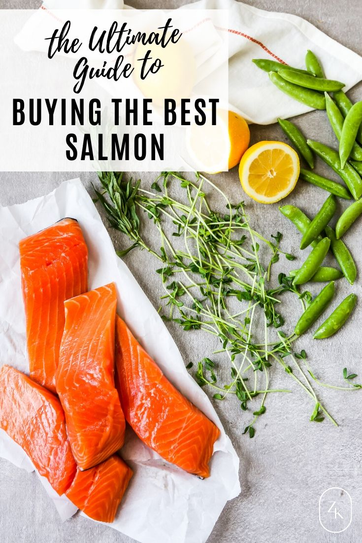 Overhead photo of fresh salmon filets stacked on a white paper with lemon, peas and herbs scattered around them, plus text overlay.
