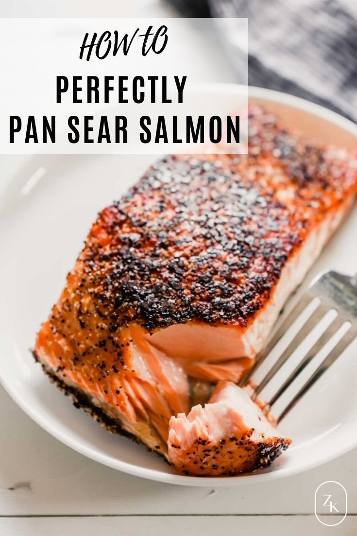 Close up photo of crispy pan seared salmon with a tender, moist interior with text overlay.