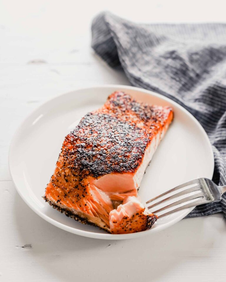 Close up photo of crispy pan seared salmon with a tender, moist interior