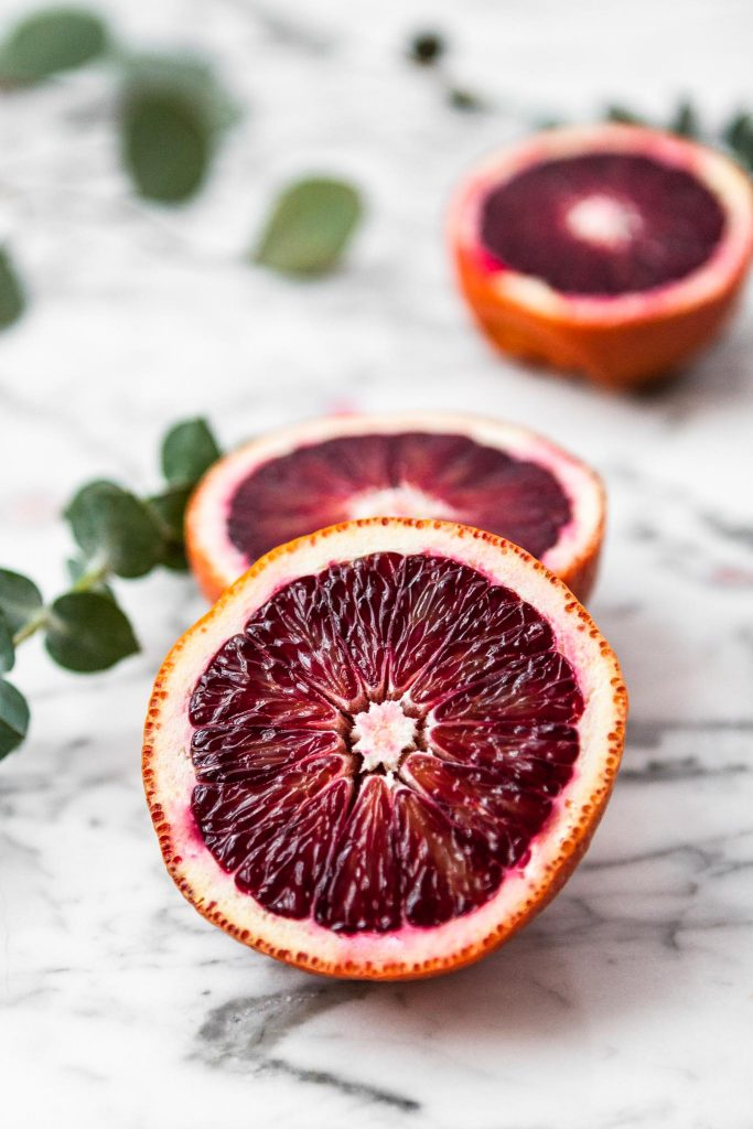 close up image of two halves of a blood orange