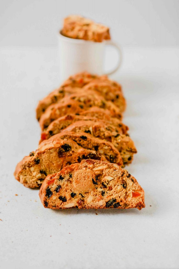 biscotti stacked sideways leaning on a white mug
