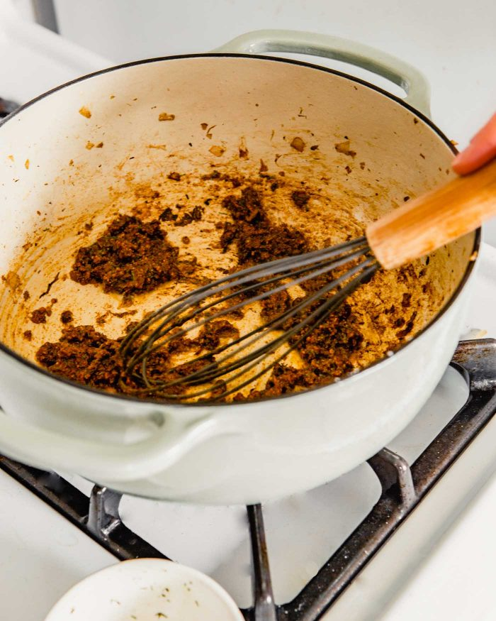 a dark-colored roux in a pan