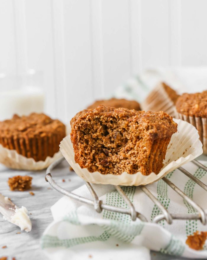 Bran muffins, split in half, set on a wire rack on a marble table