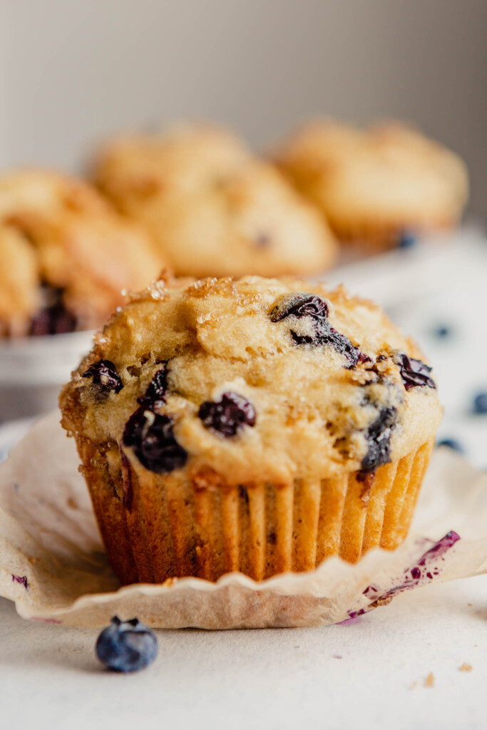image of a blueberry set on a muffin liner