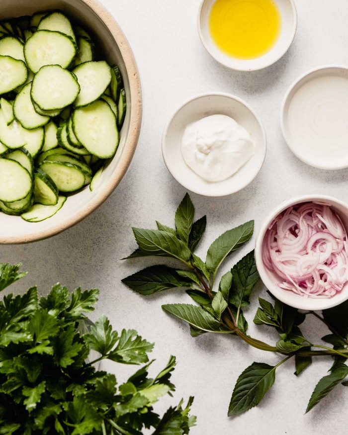 cucumbers, yogurt, vinegar, oil, shallots, and herbs mise en placed and ready for combining