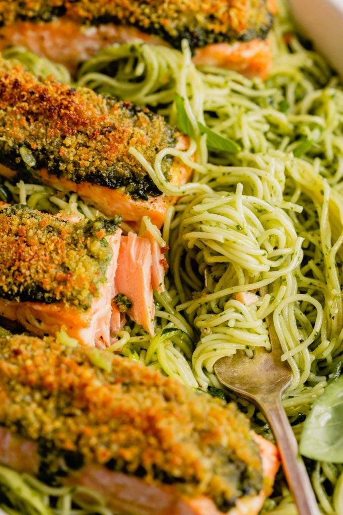 close up of pesto pasta and flaky salmon