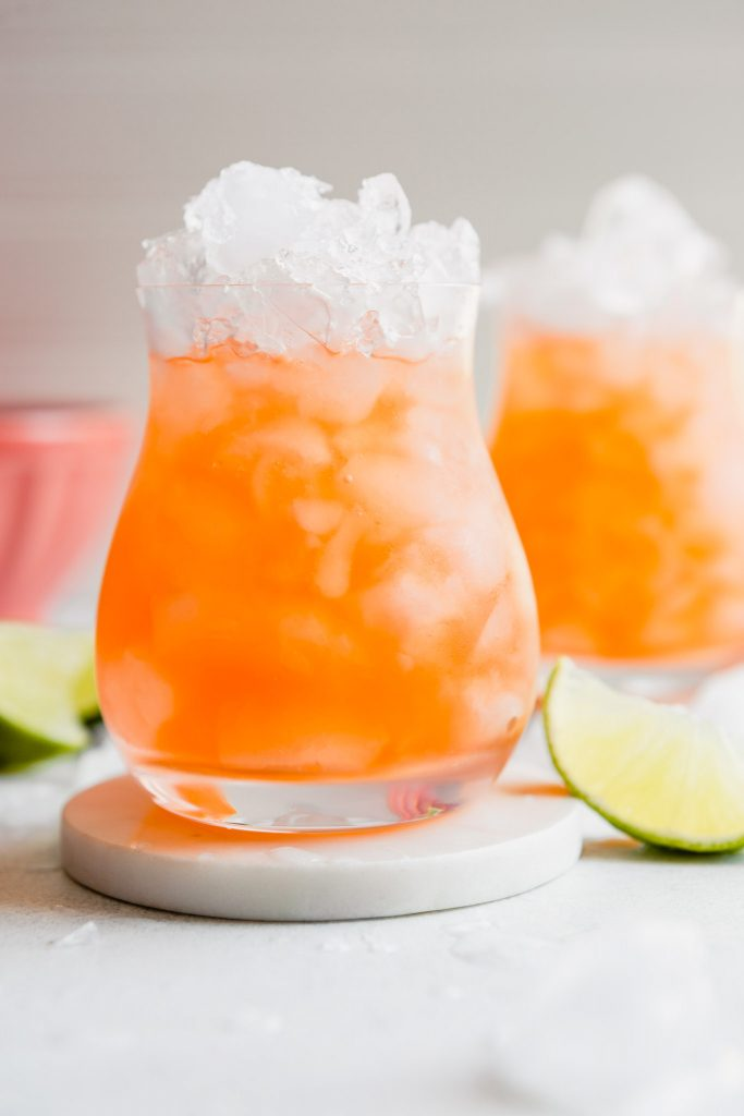 orange cocktail in a rocks glass filled with crushed ice