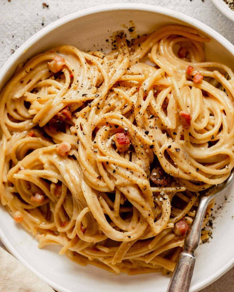 Overhead image of carbonara in a white bowl