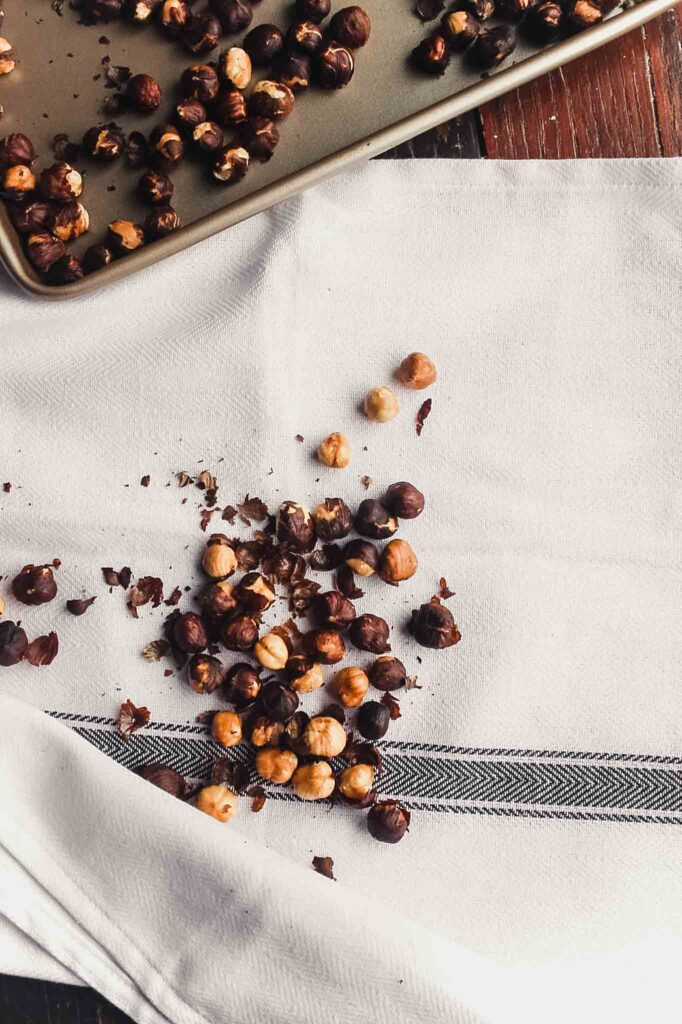 image showing how to peel toasted hazlenuts in a clean kitchen towel