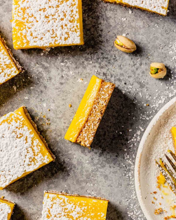 Lemon bars dusted with confectioners' sugar and set on a table